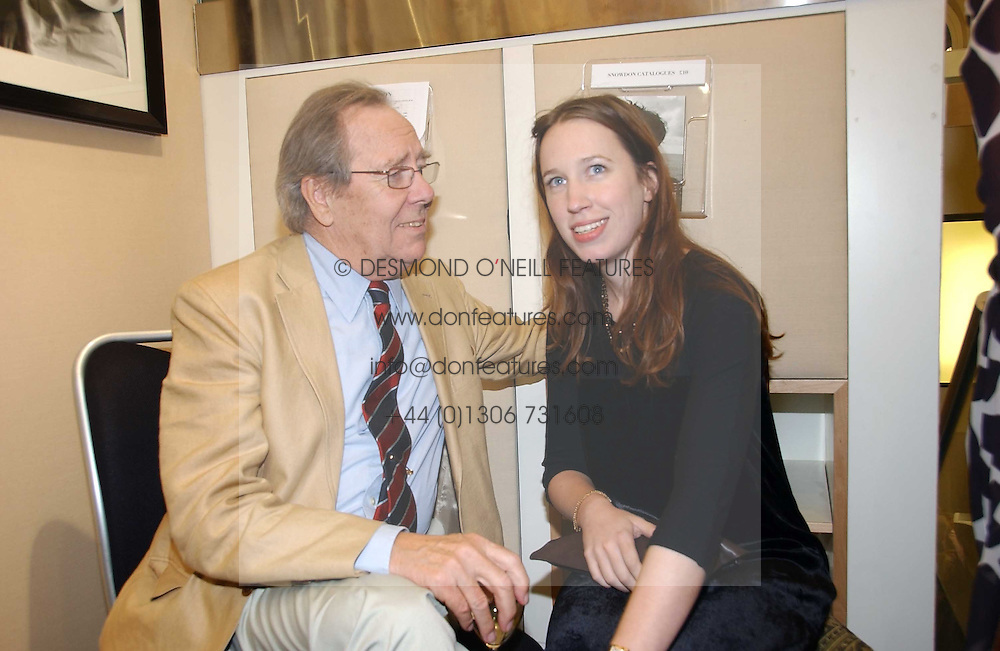 The EARL OF SNOWDON and his daughter LADY FRANCES ARMSTRONG-JONES at an exhibition of photographs by Lord Snowdon held at the Chris Beetles Gallery, Ryder Street, London on 18th September 2006.<br />