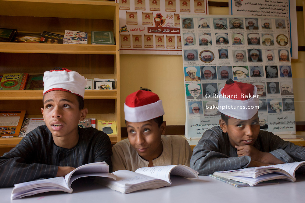 Schoolboys learn verses from the Koran in a classroom at the Islamic Koom al-Bourit Institute for Boys in the village of Qum (Koom), on the West Bank of Luxor, Nile Valley, Egypt.
