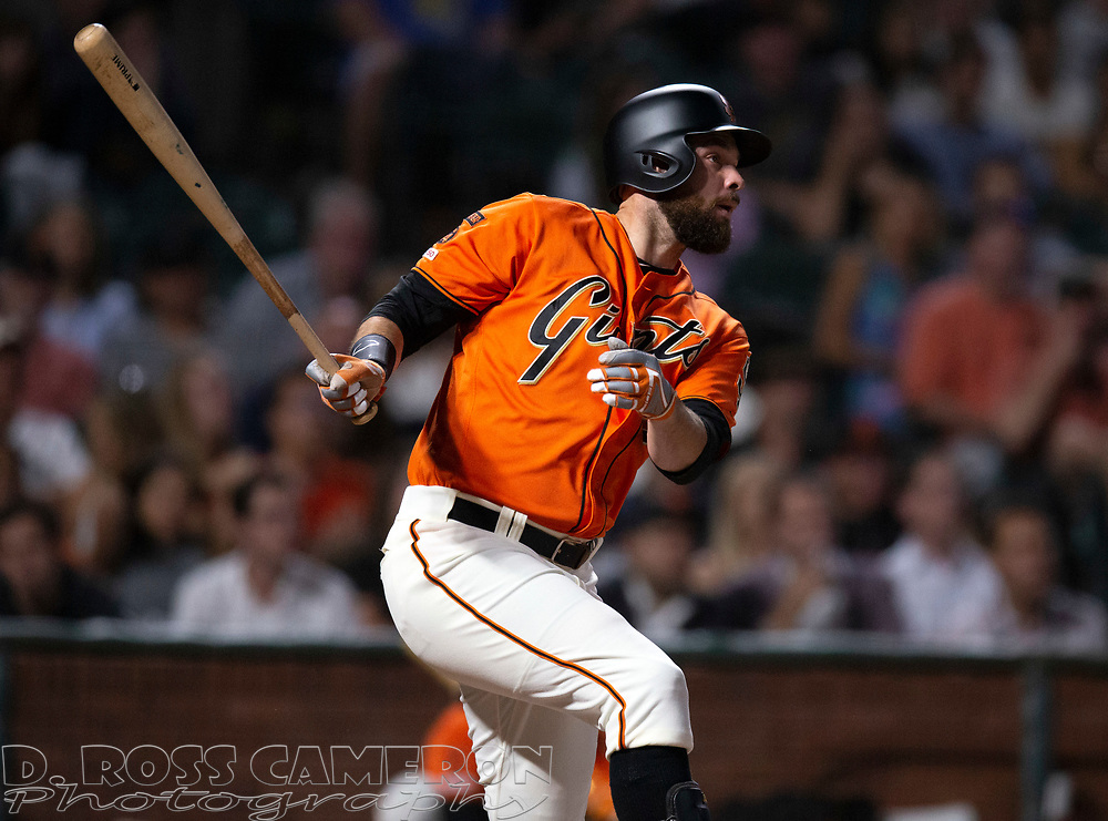 Sep 13, 2019; San Francisco, CA, USA; San Francisco Giants Brandon Belt follows through on his double against the Miami Marlins during the seventh inning of a baseball game at Oracle Park. Mandatory Credit: D. Ross Cameron-USA TODAY Sports