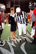 Alaska Governor Sarah Palin participates in a coin toss prior to a Alaska Wild Football game in Anchorage, AK