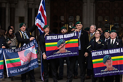 Royal Courts of Justice, London, February 8th 2017. As day two for the appeal hearing for 'Marine A' - Sgt Alex Blackman draws to a close, retired Marines and supporters gather on the steps of the High Court as his wife Claire emerges from the building. PICTURED: Supporters on the steps of the High Court.