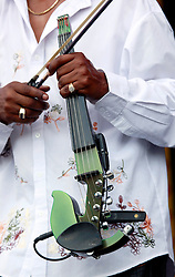 27 April 2013. New Orleans, Louisiana,  USA. .New Orleans Jazz and Heritage Festival. Michael Ward' electric violin on the Congo Square stage..Photo; Charlie Varley.