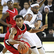 Louisiana's guard Raymone Andrews (22) spins away from Central Florida guard Marcus Jordan (5) during their game at the UCF Arena on December 15, 2010 in Orlando, Florida. UCF won the game79-58. (AP Photo/Alex Menendez)