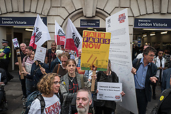 © Licensed to London News Pictures. 10/08/2016. London, UK. Commuters protest for 'fairer fares' outside Victoria Station, London. Southern Rail staff have called off the final two days of a week-long strike over job losses and passenger safety. Photo credit: Rob Pinney/LNP