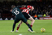 SHEFFIELD, ENGLAND - DECEMBER 05: <br /> Sheffield United's Oliver McBurnie shields the ball from Newcastle United's Jetro Willems during the Premier League match between Sheffield United and Newcastle United at Bramall Lane on December 5, 2019 in Sheffield, United Kingdom. (Photo by Rich Linley - CameraSport via Getty Images)