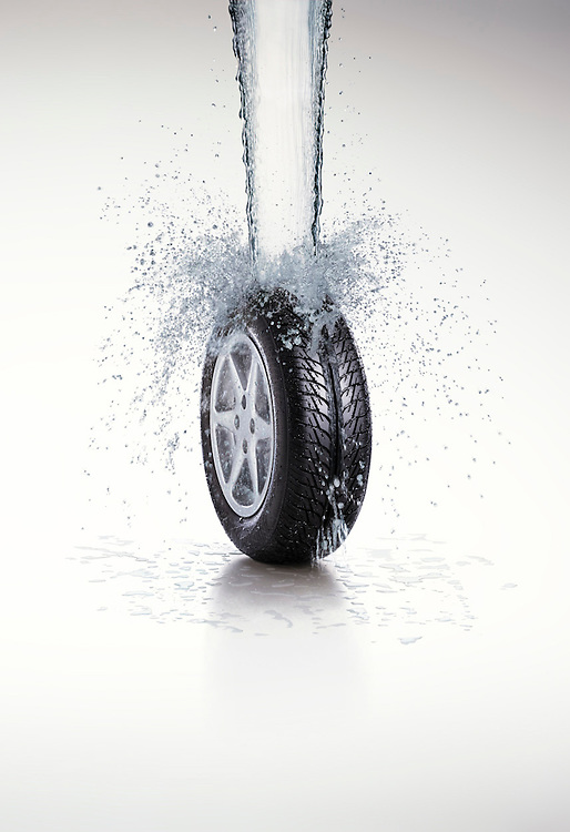 Tyre with water pouring onto it creating a splash on a white background Ray Massey is an established, award winning, UK professional  photographer, shooting creative advertising and editorial images from his stunning studio in a converted church in Camden Town, London NW1. Ray Massey specialises in drinks and liquids, still life and hands, product, gymnastics, special effects (sfx) and location photography. He is particularly known for dynamic high speed action shots of pours, bubbles, splashes and explosions in beers, champagnes, sodas, cocktails and beverages of all descriptions, as well as perfumes, paint, ink, water – even ice! Ray Massey works throughout the world with advertising agencies, designers, design groups, PR companies and directly with clients. He regularly manages the entire creative process, including post-production composition, manipulation and retouching, working with his team of retouchers to produce final images ready for publication.
