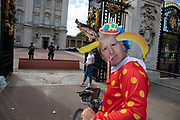 Anti Brexit protester dressed up as a clown version of Prime Minister Boris Johnson hires a Boris bike in Westminster and cycles to the gates of Buckingham Palace as it is announced that Boris Johnson has had his request to suspend Parliament approved by the Queen on 28th August 2019 in London, England, United Kingdom. The announcement of a suspension of Parliament for approximately five weeks ahead of Brexit has enraged Remain supporters who suggest this is a sinister plan to stop the debate concerning a potential No Deal.