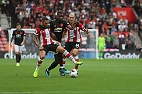 Football - 2019 / 2020 Premier League - Southampton vs. Manchester United<br /> <br /> Paul Pogba of Manchester United tries to burst past Southampton's Oriol Romeu and Southampton's Danny Ings during the Premier League match at St Mary's Stadium Southampton <br /> <br /> COLORSPORT/SHAUN BOGGUST