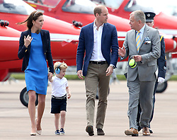 File photo dated 08/07/16 of Prince George wearing ear defenders as he walks with his parents the Duke and Duchess of Cambridge (left and centre) during a visit to the Royal International Air Tattoo at RAF Fairford - the world's largest military airshow.