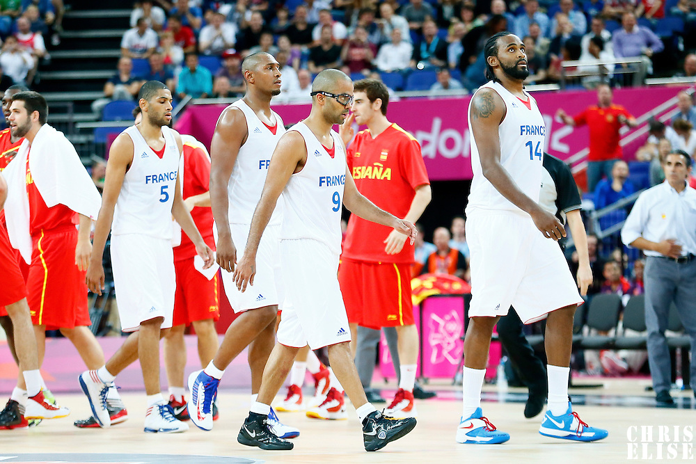 08 August 2012: France players look dejected during 66-59 Team Spain victory over Team France, during the men's basketball quarter-finals, at the 02 Arena, in London, Great Britain.