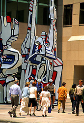 "Stock photo of business people in Houston Texas walking past downtown sculpture ""Monument Au Fantome"" by Jean Dubuffet."