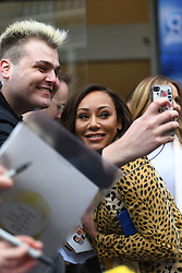 Spice Girls Melanie Brown poses for a selfie with a fan, outside Global Radio studios in Leicester Square, London.