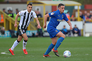 AFC Wimbledon midfielder Anthony Hartigan (8) dribbling during the EFL Sky Bet League 1 match between AFC Wimbledon and Gillingham at the Cherry Red Records Stadium, Kingston, England on 23 March 2019.