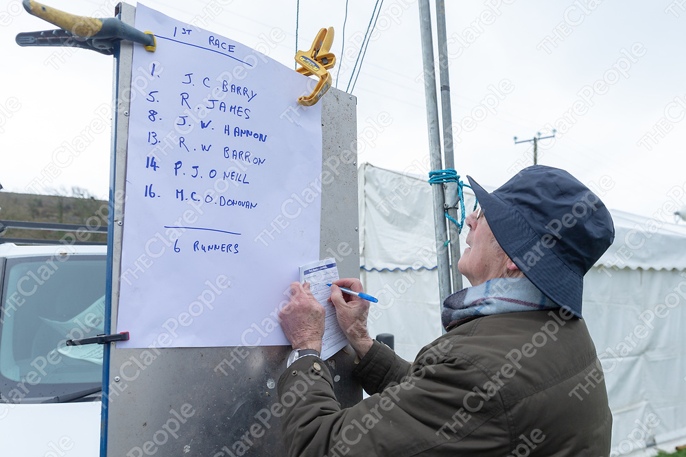 Pat Stafford from Clooney checking the details of the first race at the Bellharbour Point to Point