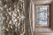 Iran. Isfahan Chehel-Sotun Palace, 17th century.Golden honeycomb shaped facade.  museum. also  Chehel Sotoon. is a pavilion in the middle of a park at the far end of a long pool, in Isfahan, Iran, built by Shah Abbas II to be used for his entertainment and receptions. In this palace, Shah Abbas II and his successors would receive dignitaries and ambassadors, either on the terrace or in one of the stately reception halls. the palace contains many frescoes and paintings on ceramic