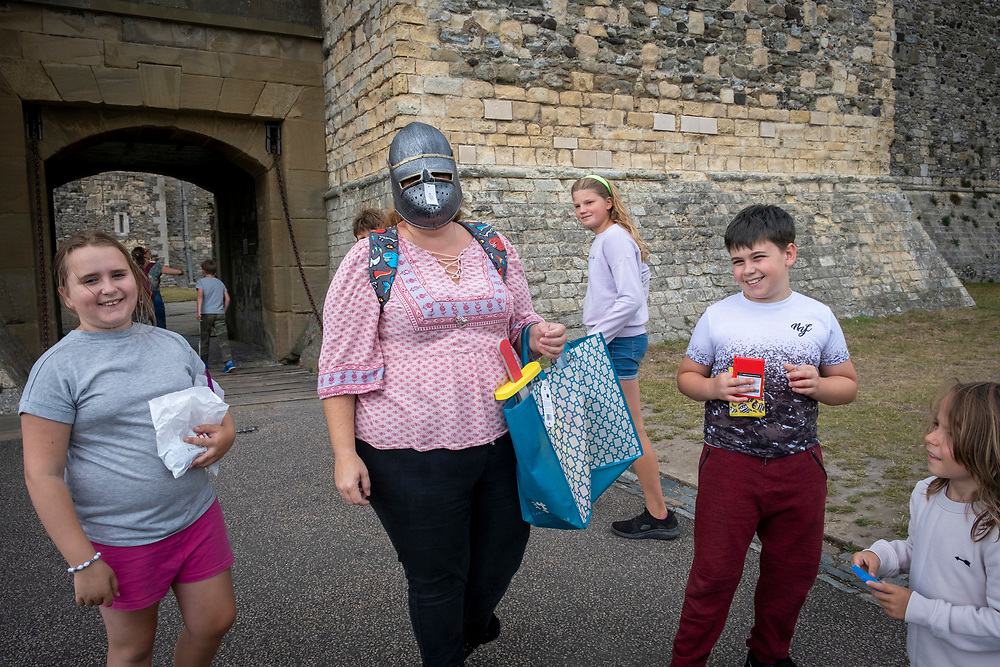A woman wears a replica knight helmet after visiting the gift shop inside Dover Castle, United Kingdom on the 26th of August 2020. COVID restrictions around Dover Castle mean that visitors are required to  wear face coverings in certain parts of the castle. Dover Castle is a medieval castle high on the hill overlooking Dover and the English Channel, it has been a significant part of British history for the past 9 centuries and is now a UK tourist attraction run by English Heritage.  (photo by Andrew Aitchison / In pictures via Getty Images)