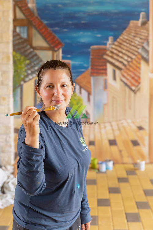 Anat Ronen created a street scene of an interactive Italian town in 2 dimensions in Creekside Park Village Green, painted on the wall next to Crust Pizza Co.