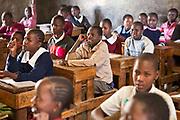 Children in Madame Dora's Phase 3 class at Mathare School in Nairobi, Kenya. Undugu Society of Kenya (USK), an NGO who run various programmes to help the school and children.