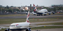 Aircraft at London's Heathrow airport on the day when air traffic controllers are expected to handle a total of 8,800 planes across the country over 24 hours, making it the busiest day in UK aviation history.