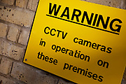 Warning sign offers information that CCTV cameras are operating in the area.