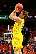 CHARLOTTESVILLE, VA- NOVEMBER 29: Zack Novak #0 of the Michigan Wolverines shoots the ball during the game on November 29, 2011 at the John Paul Jones Arena in Charlottesville, Virginia. Virginia defeated Michigan 70-58. (Photo by Andrew Shurtleff/Getty Images) *** Local Caption *** Zack Novak