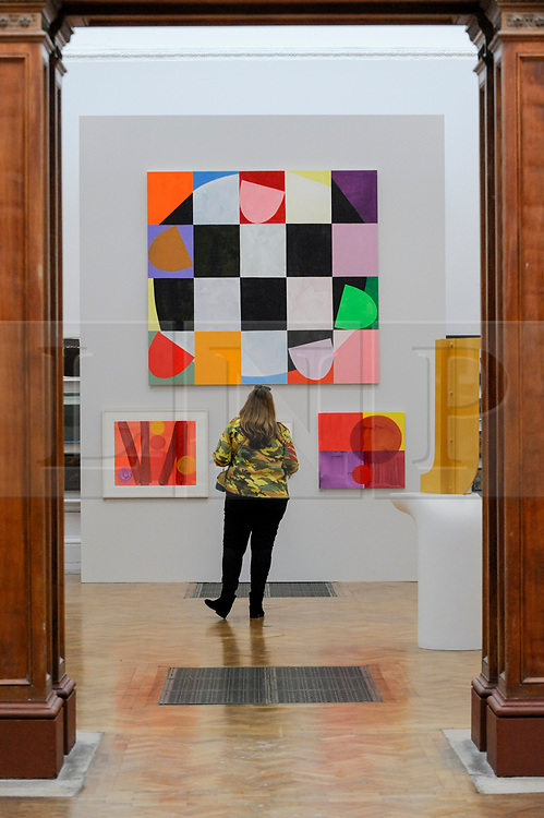 """© Licensed to London News Pictures. 08/06/2017. London, UK. A visitor views (top) """"Part-Song"""" by Mali Morris RA (GBO17,500).  Preview of the Summer Exhibition 2017 at the Royal Academy of Arts in Piccadilly.  Co-ordinated by Royal Academician Eileen Cooper, the 249th Summer Exhibition is the world's largest open submission exhibition with around 1,100 works on display by high profile and up and coming artists.<br />  Photo credit : Stephen Chung/LNP"""