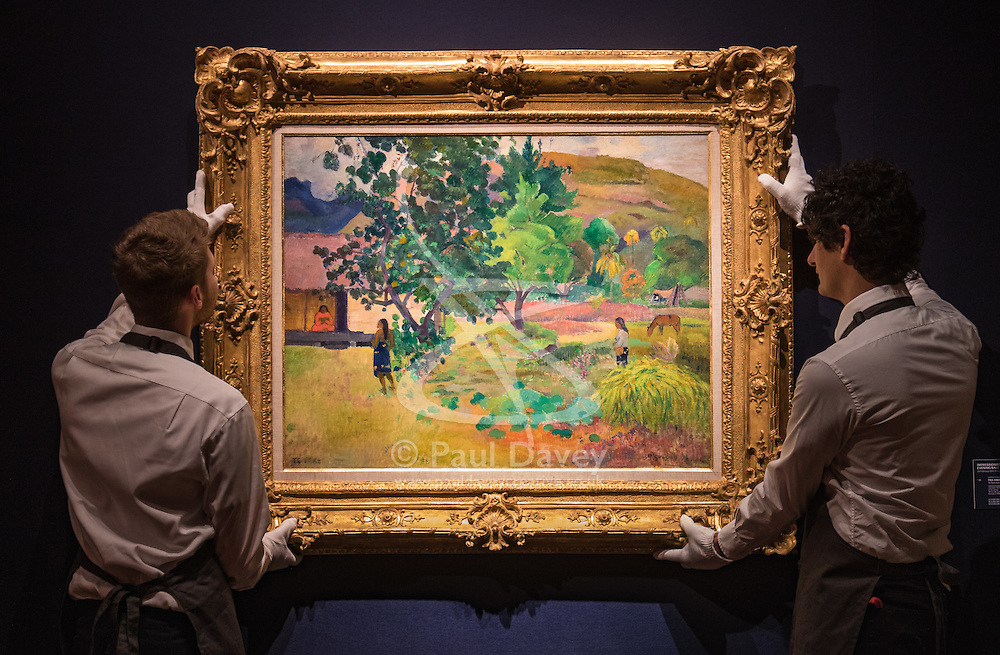 Christie's, London, February 24th 2017. Fine art auctioneers Christie's hold a press preview for their Impressionist and Modern Art and Art of the Surreal sale which takes place on 28th February. PICTURED: Gallery technicians hang Paul Gauguin's Te Fare (La maison) painted in 1892, which has an estimate of between £12-18 million.