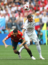 MOSCOW, July 1, 2018  Sergio Busquets (L) of Spain vies with Artem Dzyuba of Russia during the 2018 FIFA World Cup round of 16 match between Spain and Russia in Moscow, Russia, July 1, 2018. (Credit Image: © Xu Zijian/Xinhua via ZUMA Wire)