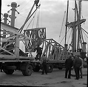 """31/07/1962<br /> 07/31/1962<br /> 31 July 1962<br /> Oil drilling equipment arrives at North Wall, Dublin. Image shows unloading of oil drilling machinery for Ambassador Irish oil loaded onto CIE truck from the """"Kendall""""."""