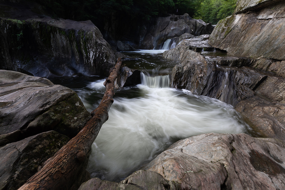 Mountain water flowing into the natural pools at Warren Falls on a summer morning.