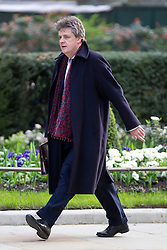 © Licensed to London News Pictures. 18/03/2014. London, UK. The Leader of the House of Lords, Lord Hill, secretary arrives for a meeting of the British cabinet on Downing Street in London today (18/03/2014). Photo credit: Matt Cetti-Roberts/LNP