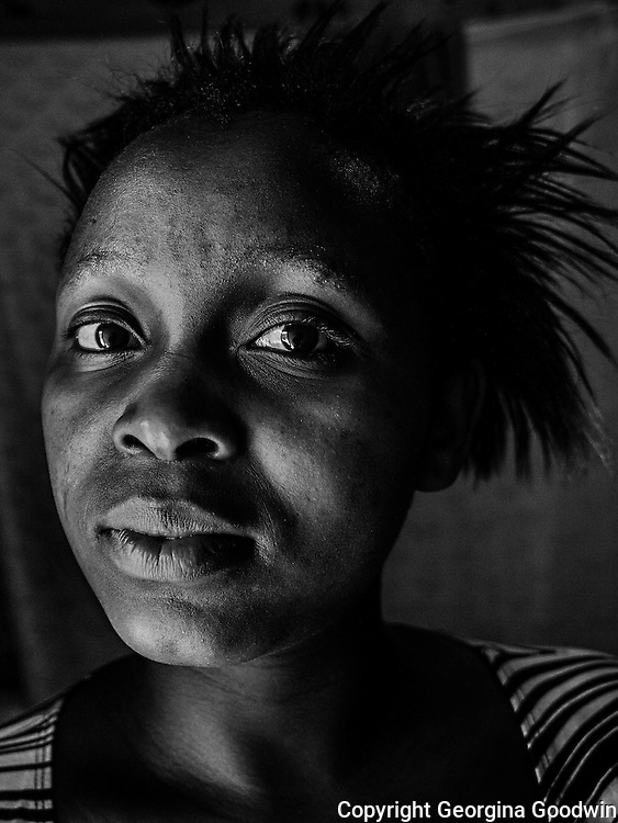 Anne Wangeshi, aged 19. Raped in December 2012 by two men, friends of her boyfriend. She has only shared with 4 friends and her boyfriend but does not have the courage to report to the police. Her father died last year and her mother does not know about the incident. <br /> This image is from a series focusing on and around the rape and the women victims that occur every half a day in Mugumoini Village in Nairobi's Southlands, a slum home to 20,000 people in abject poverty with little or no income, with the aim of creating exposure and empowerment for change. ©GGoodwin