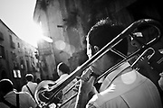 """The music band the day befor the Virgin Mary day.In Ponticelli, the eastern outskirts of Naples, for 250 years, the 5th of August is celebrated the Mother of God with the title of """"Our Lady of the Snows.""""<br /> The statue of the patron is hoisted on top of the """"Wagon"""", the heavy machinery of the party of about 17 meters, carried by hand from less than a hundred men, along the streets of the neighborhood.<br /> The Virgin is enthroned above.<br /> In Via San Rocco the people, without effort, tap the wagon from the balconies, covering it sometimes with confetti.<br /> In Naples, in the places where degradation of culture and traditions are still popular, people condense in the briefest of moments, cyclical, of the party, its history daily, made of sweat, hopes, disappointments, fatigue, illness. The party therefore assumes a character of inevitability for its ability to signify all the painful complexity of life."""