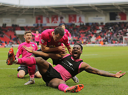 Ricardo Almeida Santos (floored) of Peterborough United celebrates scoring the winning goal with Aaron Williams (top) - Mandatory byline: Joe Dent/JMP - 19/03/2016 - FOOTBALL - The Keepmoat Stadium - Doncaster, England - Doncaster Rovers v Peterborough United - Sky Bet League One