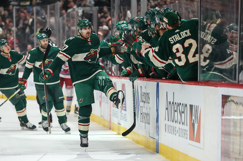 Feb 13, 2018; Saint Paul, MN, USA; Minnesota Wild forward Marcus Foligno (17) celebrates his goal with teammates during the first period against the New York Rangers at Xcel Energy Center. Mandatory Credit: Brace Hemmelgarn-USA TODAY Sports