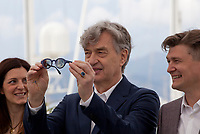 Samanta Gandolfi Branca, director Wim Wenders, writer David Rosier, at the Pope Francis – A Man Of His Word (Le Pape François – Un Homme De Parole) film photo call at the 71st Cannes Film Festival, Sunday 13th May 2018, Cannes, France. Photo credit: Doreen Kennedy