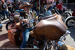Bob Invester on his hide covered 1999 Suzuki Intruder that won the Radical Bagger class in the Dennis Kirk Garage Build bike show at the Iron Horse Saloon during the Sturgis Motorcycle Rally. SD, USA. Tuesday, August 10, 2021. Photography ©2021 Michael Lichter.