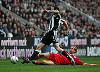 Photo. Andrew Unwin, Digitalsport<br /> Newcastle United v Middlesbrough, Barclays Premiership, St James' Park, Newcastle upon Tyne 27/04/2005.<br /> Middlesbrough's Ray Parlour (R) slides in on Newcastle's Andy O'Brien (L).