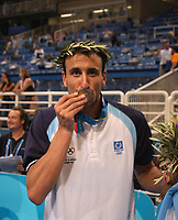 29/08/04 - ATHENS  - GREECE -  - BASKETBALL SEMIFINAL MATCH   - Indoor Olympic Stadium - <br />ARGENTINA win over ITALY and win the GOLD MEDAL<br />Argentine celebration after win the match.<br />Here EMANUEL GINOBILI  with the GOLD medal.<br />© Gabriel Piko / Argenpress.com / Piko-Press