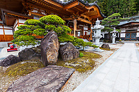 Jizo-ji Temple belongs to the Soto Zen sect of Buddhism. There is garden of kaiyu shiki teien style of the early Edo period.  Here, the backdrop and borrowed scenery have been used skillfully. Its unique Y shaped waterfall, is an unusual addition.  There is an stone bridge the crosses over the pond, festooned with iris in season while tiny islands appear to be afloat within the pond.  The garden at Jizo-ji Temple is almost hidden and takes some effort to find it behind the main hall.  Seeking it out is well worth the effort.