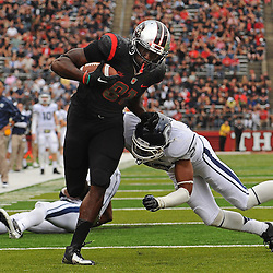 Oct 6, 2012: Rutgers Scarlet Knights wide receiver Mark Harrison (81) stiff-arms Connecticut Huskies safety Andrew Adams (22) on his way into the end zone during second half NCAA college football action between the Rutgers Scarlet Knights and UConn Huskies at High Point Solutions Stadium in Piscataway, N.J.