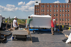 Workers unloading Roofing Materials lifted 5 stories. Bridgeport Courthouse GA 2 Renovations. Replace Roof and Masonry Repairs CT Dept of Public Works Project # BI-JD-305. Third Progress Photography Shoot: 17 August 2011