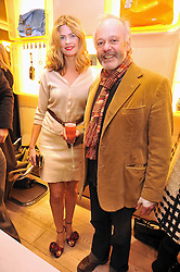 Film director MICHAEL RADFORD and EMMA TWEED at a Champagne & chocolate party hosted by Roger Vivier at their store in Sloane Street, London on 12th February 2009.  The evening was in aid of The Silver Lining charity.