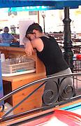 Waitress age 23 taking a break at outdoor sidewalk cafe.  Poznan Poland