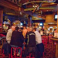Friends enjoy a drink at Whiskey Jack's bar at Big Sky Resort, Big Sky, Montana