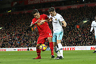 Roberto Firmino of Liverpool shields the ball from Aaron Cresswell of West Ham United. Premier League match, Liverpool v West Ham Utd at the Anfield stadium in Liverpool, Merseyside on Sunday 11th December 2016.<br /> pic by Chris Stading, Andrew Orchard sports photography.