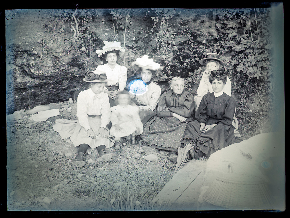 family casually posing in garden setting Frane ca 1920s