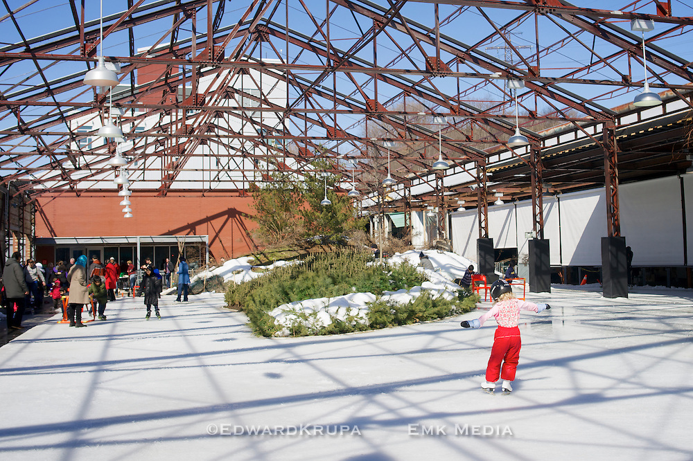Young girl learning how to skate on a rink at the Evergreen Brickworks in Toronto.