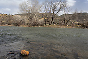 """CREDIT: Steven St. John for The Wall Street Journal<br /> """"ANIMAS""""<br /> <br /> A discolored rock sits above the water line in the Animas River on Tuesday, March 22, 2016. Six months after an EPA crew triggered a toxic spill at a Colorado gold mine, state and local officials downstream are scrambling to prepare for a new emergency as spring snow melt threatens to stir up lead and other contaminants in a river used for drinking water."""