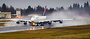 A Delta Air Lines 747 that will retire by year end [2017], one of the last of these jumbo jets to fly for a U.S. carrier, visits its birthplace, Everett, on a farewell tour of the country. The jumbo jet lands at Paine Field on a wet and rainy morning. (Mike Siegel/The Seattle Times)
